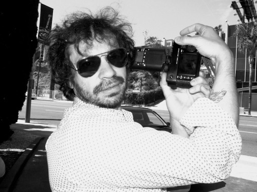Attention all Leica fans! Purple's Olivier Zahm proudly shares with me his new Leica M9 yesterday at the parking lot of the Standard Hotel at 2:05pm. Photo by Brad Elterman