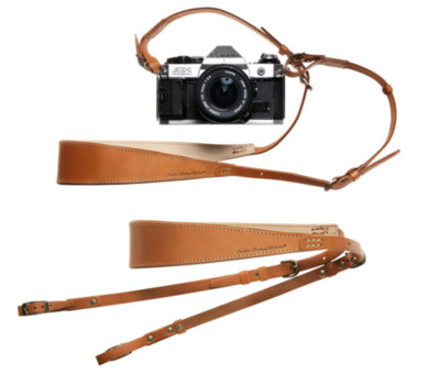 Kauffman Mercantile - Roberu Leather Camera Strap Designed and manufactured in Roberu's tanneries just north of Tokyo and further south in Yokohama, this strap was designed specifically with the compact camera in mind. Sleek and elegant, it can support up to three kilograms. Pack it up, take it with you, saddle up the camera and shoot. Reinforced with two sheets of leather at the back of the neck for maximum strength and comfort, the strap is held together with brass rivets and dual buckles. Adjustable to four different lengths, you can wear it around your neck or draped from your shoulder.