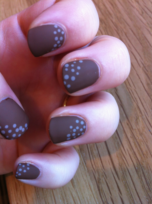 Matte and speckled. Reminds me of a little bird or fawn.