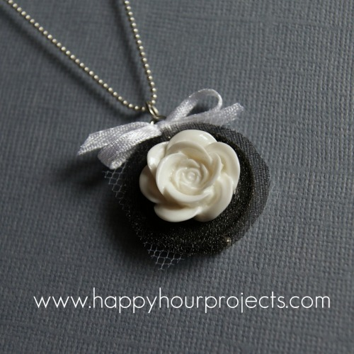 DIY Rose Pendant. I have posted before how to make these resin roses here, or you can buy them super cheaply on Ebay or Etsy here. Beyond easy Tutorial from Happy Hour Projects here.