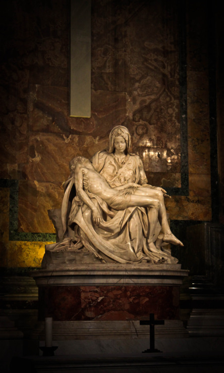 "A Muslim's ""Turning Point"" Standing Before Michelangelo's Pietà The Pietà by the young Michelangelo is one of the world's most recognized and priceless works of art.  This past Lent and Holy Week, I'm sure that you've seen many images of the Pietà which depict that moment when the pierced and blood Body of Jesus is placed in Mary's arms.  As the literal name for this most lamentable scene implies, many people's reaction is ""pity"" or ""compassion"". I remember taking the photo above when I made a pilgrimage to Catholic Disneyland Rome last October.  Sadly, upon seeing this famous sculpture, I am ashamed to admit, that my first reaction was not one of pious devotion.  Rather, I was a little annoyed that so many people were gathered around the small chapel (next to Bl. John Paul the Great's tomb) where the Pietà is displayed behind bullet proof glass.  As I maneuvered my way through the crowd of tourists, all I was focused on was getting the shot.  Once I got to the front of the crowd, I was struck by the great cultural, historical, and artistic significance of this piece.  Then, I was moved by the broken, lifeless body of Christ held in the lap of His Mother. With her left hand, Mary tenderly bears the Savior of the World, and with her right hand, she raises her palm up to heaven, every ready to accept and follow the will of God. While still basking in the joyful light of the Resurrection, I cannot help but see Michelangelo's Pietà as an image of the Church:  our ancient but ever youthful Mother who embraces the cross and presents the Body of Christ to the Body of Christ.  For us Catholics, art is more than church decoration, something pretty to look at.  Art can provide us with an encounter with God who is the source of all that is True and Good and Beautiful.  In 2009, Pope Benedict XVI addressed a group of artists in another of Michelangelo's masterpieces, his incredible Sistine Chapel.  Before the Last Judgement and under the Creation of Man, our Holy Father—a great lover of beauty—spoke these very poetic words:  Unfortunately, the present time is marked, not only by negative elements in the social and economic sphere, but also by a weakening of hope, by a certain lack of confidence in human relationships, which gives rise to increasing signs of resignation, aggression and despair. The world in which we live runs the risk of being altered beyond recognition because of unwise human actions which, instead of cultivating its beauty, unscrupulously exploit its resources for the advantage of a few and not infrequently disfigure the marvels of nature. What is capable of restoring enthusiasm and confidence, what can encourage the human spirit to rediscover its path, to raise its eyes to the horizon, to dream of a life worthy of its vocation — if not beauty? Dear friends, as artists you know well that the experience of beauty, beauty that is authentic, not merely transient or artificial, is by no means a supplementary or secondary factor in our search for meaning and happiness; the experience of beauty does not remove us from reality, on the contrary, it leads to a direct encounter with the daily reality of our lives, liberating it from darkness, transfiguring it, making it radiant and beautiful. Indeed, an essential function of genuine beauty, as emphasized by Plato, is that it gives man a healthy ""shock"", it draws him out of himself, wrenches him away from resignation and from being content with the humdrum — it even makes him suffer, piercing him like a dart, but in so doing it ""reawakens"" him, opening afresh the eyes of his heart and mind, giving him wings, carrying him aloft. Dostoevsky's words that I am about to quote are bold and paradoxical, but they invite reflection. He says this: ""Man can live without science, he can live without bread, but without beauty he could no longer live, because there would no longer be anything to do to the world. The whole secret is here, the whole of history is here."" The painter Georges Braque echoes this sentiment: ""Art is meant to disturb, science reassures."" Beauty pulls us up short, but in so doing it reminds us of our final destiny, it sets us back on our path, fills us with new hope, gives us the courage to live to the full the unique gift of life. The quest for beauty that I am describing here is clearly not about escaping into the irrational or into mere aestheticism. Too often, though, the beauty that is thrust upon us is illusory and deceitful, superficial and blinding, leaving the onlooker dazed; instead of bringing him out of himself and opening him up to horizons of true freedom as it draws him aloft, it imprisons him within himself and further enslaves him, depriving him of hope and joy. It is a seductive but hypocritical beauty that rekindles desire, the will to power, to possess, and to dominate others, it is a beauty which soon turns into its opposite, taking on the guise of indecency, transgression or gratuitous provocation. Authentic beauty, however, unlocks the yearning of the human heart, the profound desire to know, to love, to go towards the Other, to reach for the Beyond. If we acknowledge that beauty touches us intimately, that it wounds us, that it opens our eyes, then we rediscover the joy of seeing, of being able to grasp the profound meaning of our existence, the Mystery of which we are part; from this Mystery we can draw fullness, happiness, the passion to engage with it every day. In this regard, Pope John Paul II, in his Letter to Artists, quotes the following verse from a Polish poet, Cyprian Norwid: ""Beauty is to enthuse us for work, and work is to raise us up"" (no. 3). And later he adds: ""In so far as it seeks the beautiful, fruit of an imagination which rises above the everyday, art is by its nature a kind of appeal to the mystery. Even when they explore the darkest depths of the soul or the most unsettling aspects of evil, the artist gives voice in a way to the universal desire for redemption"" (no. 10). And in conclusion he states: ""Beauty is a key to the mystery and a call to transcendence"" (no. 16). These ideas impel us to take a further step in our reflection. Beauty, whether that of the natural universe or that expressed in art, precisely because it opens up and broadens the horizons of human awareness, pointing us beyond ourselves, bringing us face to face with the abyss of Infinity, can become a path towards the transcendent, towards the ultimate Mystery, towards God. Art, in all its forms, at the point where it encounters the great questions of our existence, the fundamental themes that give life its meaning, can take on a religious quality, thereby turning into a path of profound inner reflection and spirituality.  An example of the powerful effect of beauty is Ilyas Khan, a British philanthropist, soccer team owner, and former Muslim.  In an interview with the National Catholic Register, Khan describes how Michelangelo's Pietà, a piece of art over 500 years old, helped to bring him home to the Catholic Church.  Were Blessed John Paul II and Pope Benedict XVI also influential? Both have been described as so-called Balthasarians. That's a really good question. I've never been asked that question before. Yes, well, Cardinal Ratzinger, the current Pope, definitely qualifies as being ""Balthasarian,"" and Blessed John Paul II raised Balthasar to becoming a cardinal. Obviously, John Paul II was an influence beyond his regard for Von Balthasar — how could one not be influenced by such a great man? Like a great many people, Balthasar himself was not just a gigantic intellect, but also articulated how the mystery of faith is central to our lives as Christians. And, in that regard, the single most moving moment for me happened when I was in my mid-30s. I was walking past the Pieta in St. Peter's, and I remember being literally arrested in my tracks by a combination of four or five things all at once. You asked me about my relationship with the Blessed Mother of God — well, that moment in time was really important. That can be described as being the turning point. Was it the beauty of the Pietà that struck you? Yes — and the context. This is God, I thought. This really is God. You must remember that one of the big things when we look at traditional Islam is the heresy — in their opinion — of equating the mortal Jesus with God. And if there is ever an obstacle that a Muslim convert has to contend with, intellectually and emotionally, more than anything else, that is it. At that moment, in front of the Pietà, I realized, through sheer emotion, that the truth of our religion is so simple and so direct."