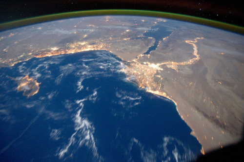 suburbanastronaut:  River Nile delta and Mediterranean Sea at night as seen from the International Space Station, 15 October 2011.