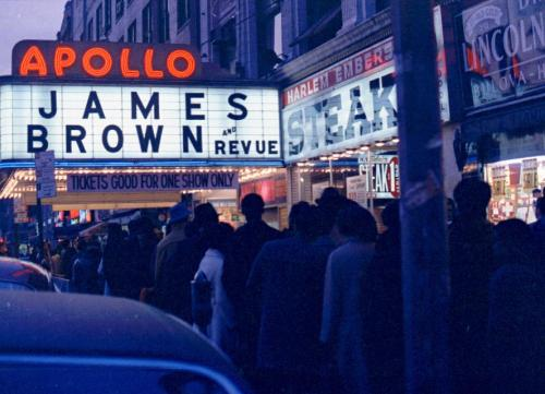 Crowds queue for James Brown at the Apollo, Harlem.