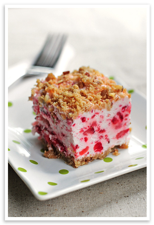 "gossipchef:  Frozen Strawberry Squares Ingredients 1 cup flour 1/4 cup brown sugar 1/4 cup slivered & chopped almonds (other chopped nuts may be substituted) 1/2 cup melted butter 2 egg whites 1/2 cup granulated sugar 10 fluid ounces whipping cream 2 tablespoons fresh lemon juice 2 cups sliced fresh strawberries, crushed/smashed Instructions Preheat oven to 325° F. Combine flour, brown sugar, almonds and melted butter and spread in 8x8"" pan. Bake at 325°F for 20 minutes. Stir a couple of times. Cool Once cooled, evenly press 2/3 of the mixture in the 8x8"" pan to create crust. Beat egg whites and granulated sugar until stiff. Beat whipping cream until soft peaks form. Gently combine, beaten egg whites, whipped cream, lemon juice, and crushed strawberries. Spread mixture over crust. Sprinkle remaining crust/crumb mixture on top. Freeze for 3-6 hours. Cut in squares to serve. Garnish with additional strawberries if desired."