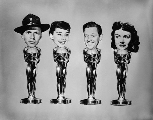 Oscar caricatures with faces of 1954 winners Frank Sinatra, Audrey Hepburn William Holden, and Donna Reed. —- Image by © Bettmann/CORBIS © Corbis. All Rights Reserved.