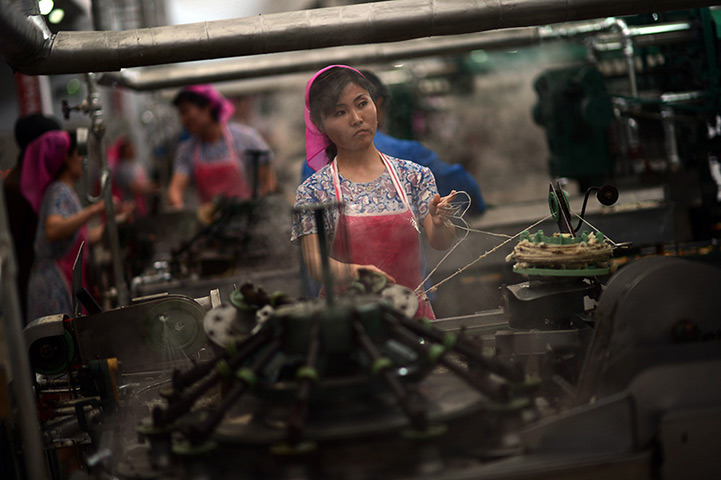 Women work in the Kim Jong-suk Pyongyang Silk Mill in Pyongyang, April 9, 2012.  [Credit : Pedro Ugarte/AFP/Getty Images]