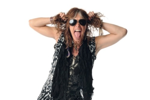 "Aerosmith's Steven Tyler tells us the life cycle of his clothing & accessories: ""When I found a good shirt, I wore it to death until it turned into a rag, and I hung it from the mike stand. Then I turned that into a scarf, and that scarf turned into something else. At first, it hurt so much to think that someone might feel that it wasn't cool, but I went, F—k it. I didn't care what people thought."" [Photo: Kevin Mazur / WireImage-Getty Images]"