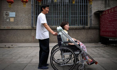 "amnestyusa:  Ni Yulan, who is disabled, was handed a two year and eight-month sentence for ""picking quarrels and making trouble"" and ""fraud."" Her husband, Dong Jiqin, has been jailed for two years for ""picking quarrels and making trouble"". Unacceptable.  Picture source: The Guardian"