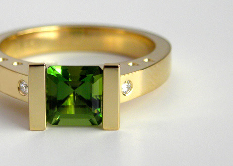 Custom made green tourmaline ring in 18k yellow gold.