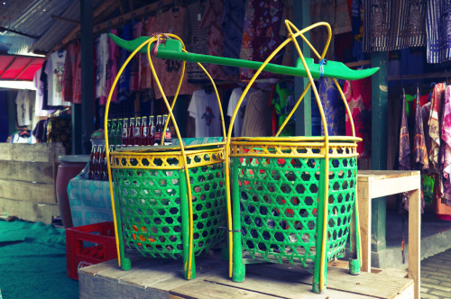 Baskets | Striking colours for two rather ordinary but useful baskets at a bazaar near Borobudur.  The world always seems brighter when you've just made something that wasn't there before. Neil Gaiman