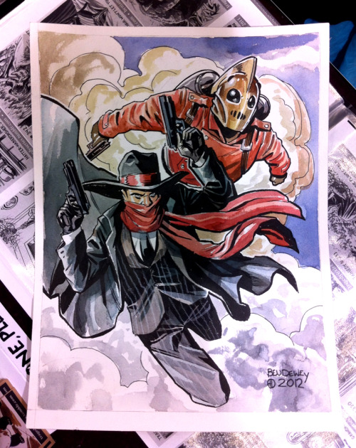periscopestudio:  Ben Dewey did this painting of The Rocketeer and The Shadow at Emerald City Comic Con. To see more of his work or to order your own commission you can check out his website www.benjamindewey.com