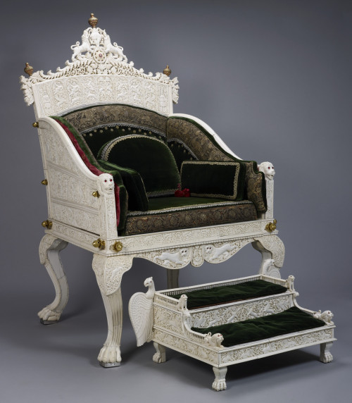 "omgthatartifact:  Chair and Footstool India, 1845-1855 The Royal Collection ""This spectacular throne, the centrepiece of the Indian section in the Great Exhibition, was presented to Queen Victoria in part to advertise the carving skills of Travancore in southern India. The densely-carved elephant-ivory plaques incorporate Indian and European motifs, and the conch-shell emblem of Travancore forms the cresting."""