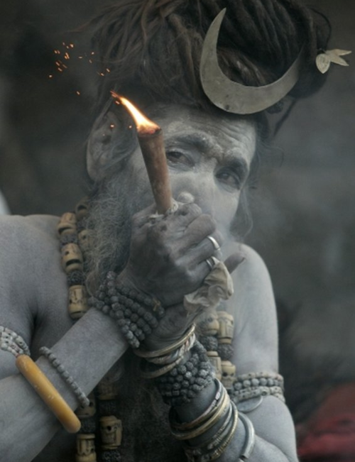 Aghori, smoking out of a chillum
