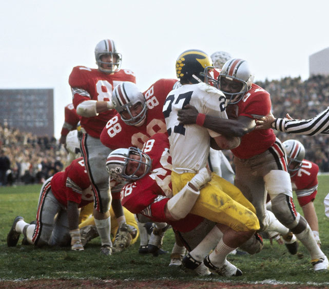 Ohio State safety Jack Tatum (32) and defensive end Jim Stillwagon tackle a Michigan running back during a 1970 game between the two rivals. (Walter Iooss Jr./SI)   GALLERY: Top 10 Michigan-Ohio State Games Since 1950