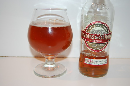 "#314: Innis & Gunn Original – Innis & Gunn, Edinburgh, Scotland A review I had to get to sooner or later. It seems it's that kind of week so far; doing bucket list reviews. Innis & Gunn as a company was kind of an accident. The original idea was to create something like ""Ale Reserve Whisky,"" so beer would've been placed into the barrel, set to age, and then removed and discarded, so whisky could take its place and be infused with ale flavors. Apparently the beer was too good to get rid of. Innis & Gunn Original is aged in oak Bourbon barrels and matured for 77 days, imparting all sorts of lovely flavors into this 6.6% ABV brew. I always get annoyed when I see these clear bottles, I can't help it. But I will say, it did look very, very, very appealing when I pulled it out of the 'fridge. Looking at it in the bottle, it really does look quite a bit like whiskey. It has that scorched orange color that the drink is so well-known for. The head creamed up initially, but quickly settled out to the thin rim you see there. The aroma is just damn delightful. Tons and tons of vanilla, to go along with strong toffee and caramel, and a touch of that whiskey-ish booze. And yet somehow it still manages to taste like beer, even with all of the flavors that have been imparted. The vanilla continues to come right on through, though it's comparatively soft when you stack it up next to the nose. Certainly strong caramel and toffee flavors take up a good portion the room, joined by an underlying smokiness and that rich, warming whiskey-ish flavor that hangs on the edges. All of these flavors are wrapped nicely in the body, which has a nice ""oomph"" to it. Oak comes through in the finish, as it always does. The Verdict: A must try, quite simply."