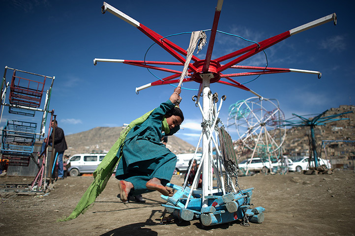wantsee:  Kabul, Afghanistan: A girl plays near the Kart-e-Sakhi shrine Photograph: Johannes Eisele/AFP/Getty Images
