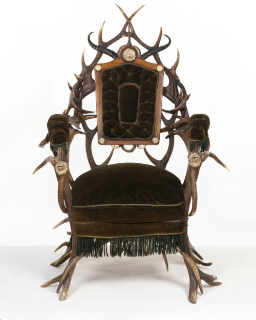 "omgthatartifact:  Armchair Germany, 1850 The Victoria & Albert Museum ""Only the back and seat of this chair are of wood, upholstered in green wool plush. The rest of the frame is entirely made up of stags' antlers (from two different species of deer), goat horns and boar tusks. Such furniture may seem rather gruesome to modern taste. It was extremely fashionable, however, in the years around 1850, although it must always have been very expensive and thus confined to a small market. People of the time were quite unworried about the conservation of natural species. They readily used feathers and stuffed birds for their hats and stuffed birds and animals for interior decoration, with animal-skin rugs on the floors. Furniture such as this was considered suitable for hunting lodges, where the day might be passed in stalking and shooting the same kind of deer. Such furniture was available throughout Northern Europe and in North America, but it seems to have been particularly popular in the German states. The best-known manufacturer was H. F. C. Rampendahl of Hamburg, who exhibited at several of the international exhibitions."""