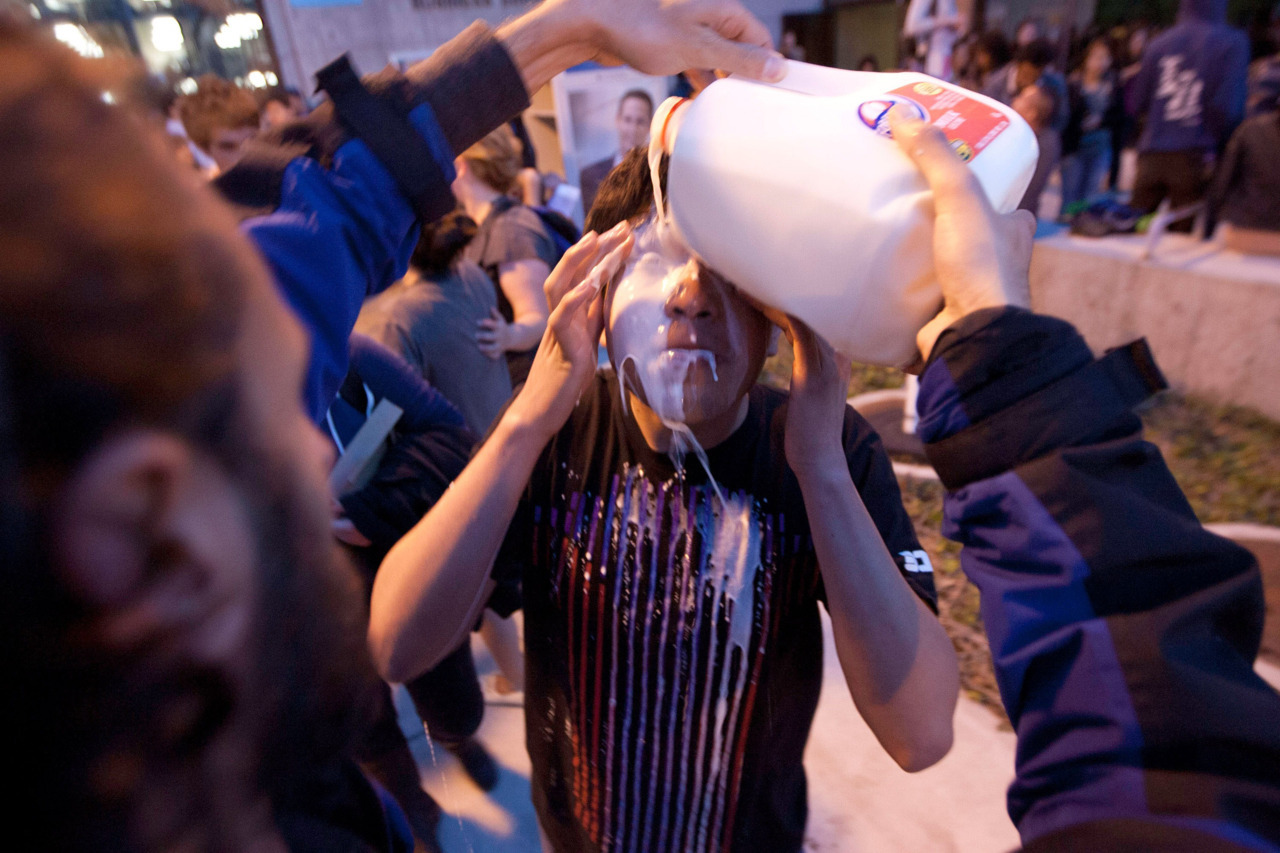 A young man has milk poured into his eyes to counteract pepper spray outside of a Board of Trustees meeting at Santa Monica College, in California. The college's president said police sprayed students only after they tried to force their way into the boardroom. (Michael Yanow, Getty Images)