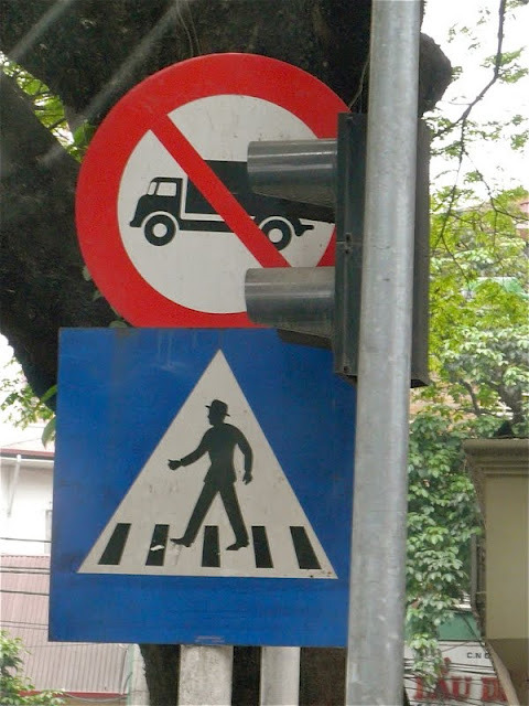Watch out… man crossing a piano wearing a hat!