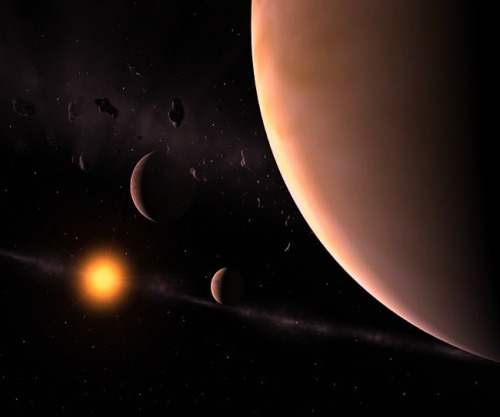 scinerds:   A Star With Nine Planets, Maybe More?  Exactly how many planets orbit any given star is still a major unknown in exoplanetary science. The two primary techniques for detecting planets and quantifying their characteristics have significant limitations that blinker us to the full contents of other solar systems. Radial velocity measurements pick up the tell-tale motion of a star around a system's common center-of-mass, or balance point, due to the gravitational pull of any planets. But the smaller the planets and the further they are from the star the weaker the signal. Multiple planets and longer orbital periods confound the situation by producing complex patterns that may also be incompletely sampled in data that spans only a few years. Transit observations, such as those undertaken by the Kepler mission, are biased towards the detection of large planets in small orbits around small stars where it is most likely for a planet to block the light from the star more frequently. All of this means that in essentially all currently known systems we may have only incomplete information about the true number of orbiting planets. Nonetheless, stars with multiple planet detections certainly crop up. Of the over 550 confirmed exoplanetary systems there are over 90 with more than one planet (a total of more than 760 worlds). Now a new study of radial velocity data from the HARPS instrument suggests that one of these systems, HD 10180, may harbor ninemajor planets – usurping our own solar system from the top of the pile of planetary richness.  Continue reading on Scientific American