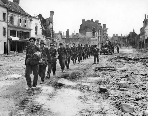 "livelymorgue:  Aug. 25, 1944: ""The Allied War Machine Rolls Through France on Both Fronts,"" read the headline above this photo, which shows Nazis in France captured by Canadian troops. The picture ran with an article by André Lebord, the pseudonym of a French underground leader, as told to Leland Stowe. ""This was the hour that more than 500,000 French patriots had been living for, through months and years of hunger and heartbreak,"" it said. Photo: The New York Times"