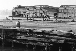 "June 18, 1978: An abandoned pier collapsed into the Hudson River at Bethune Street in Greenwich Village, but that didn't faze sunbathing New Yorkers. After all, they considered the piers their beaches, according to an  article published two years later. ""The pier in the Village replaces the stoop,"" one West Village resident, Robert Lienhardt, was quoted as saying. ""There is no other major place to get the sun."" Photo: Paul Hosefros/The New York Times"