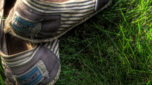 "The Broken ""Buy-One, Give-One"" Model: 3 Ways To Save Toms Shoes  First, the Toms buy-one-give-one model does not actually solve a social problem. Rather, the charitable act of donating a free pair of shoes serves as little more than a short-term fix in a system in need of long-term, multi-faceted economic development, health, sanitation, and education solutions. ""What's wrong with giving away shoes?"" you might be thinking. ""At least they're doing something."" The problem, we've learned, is when that ""something"" can do more harm than good.  Read on->"