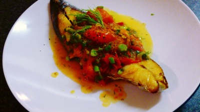 Mackerel in tomato sauce. Everyone loves a dish of good seafood. It has a nice ring to it, sounds expensive and sophisticated. However the exact reason puts people off trying at home, too much effort I guess. So today in a craze for Omega 3 intake I went down the super market and pick up a bundle of dill and tomatoes for my mackerel dish. This recipe all in total takes 30 minutes The recipe down here is in courtesy of http://simplyvietnamese.wordpress.com/2009/10/24/fish-with-sweet-tomato-sauce/ with some personal modification. 6 tbsp olive oil (any oil will do really) 1.5 lbs tomatoes, roughly chopped (or quarter as I did) 2 chopped cloves of garlic 1/3 cup sliced onion 1 tsp salt black pepper to taste 2 tbsp fish sauce (optional) 1 tbsp sugar 4 filets of fish chopped dill and green onions for garnish. Sequence: To save time you can fry the fish first and then prepare the ingredient since it takes considerable time for the fish to be cooked in low heat. 1.  Heat 2 tbsp oil in large frying pan on medium high heat and sautee the onions until translucent.  Add the garlic and give it a quick stir.  Add tomatoes to the pan.  Salt the tomatoes, add water to cover the tomatoes.   Adjust heat to medium-low and simmer the tomatoes, occasionally stirring the pan until the mixture becomes a thick sauce with chunks of tomatoes – about 7-10 minutes. Add sugar, fish sauce now, 2/3 of the chopped green onions and dill and stir. Set aside 2.  In a separate large frying pan, add the rest of the olive oil, and pan-fry two fillets at a time. The trick is in the heat which means gas stove is preferred over hob but I cooked mine under a hob so no sweat. Heat the oil gradually under low heat until you see bubbles in the oil and then add the fish. Use low heat to let the fish cooked without being burned, you should not add new filet in while the others are still cooking as it will lower the heat and make considerable change in texture. When the filets are golden on both sides, set aside.   4.  Plate the pan-fried filet of fish and generously top with tomato sauce.   Garnish with the rest of chopped dill and green onion, sprinkle with black peppers and serve immediately with rice.  For alcohol lover, I recommend white wine or rice wine, Sake would not work because it's too sweet. This should be the main dish, side dish can be green salad, salty roasted peanuts, pickles, fried tofu. Happy Oriental fish recipe :)