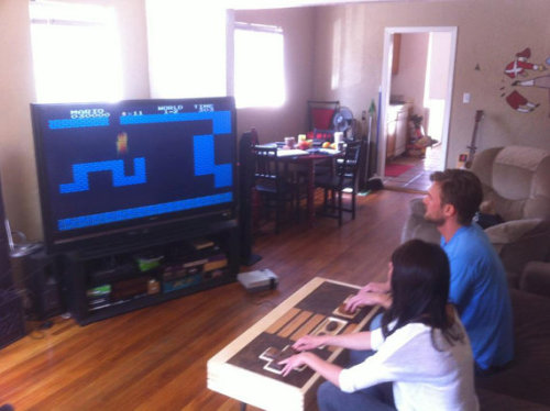 brain-food:  Functional Nintendo NES Controller Coffee Table It may be hard to believe at first glance, but this oversized Nintendo NES controller actually works. The table is constructed from high quality materials including maple, mahogany, and walnut with dovetail joinery and mid century modern legs. If you have $3500 just laying around, you can pick it up now from Etsy.