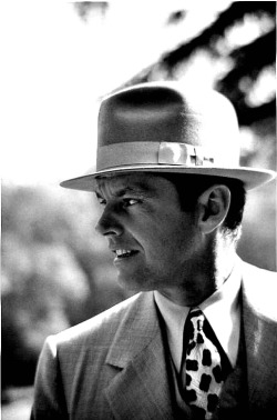 "Jack Nicholson as Jake Gittes in Chinatown.  Nicholson had the name ""Jake Gittes"" written on the shirts he used in the movie. Though this is not shown, it was done so Nicholson could enter in character more easily."
