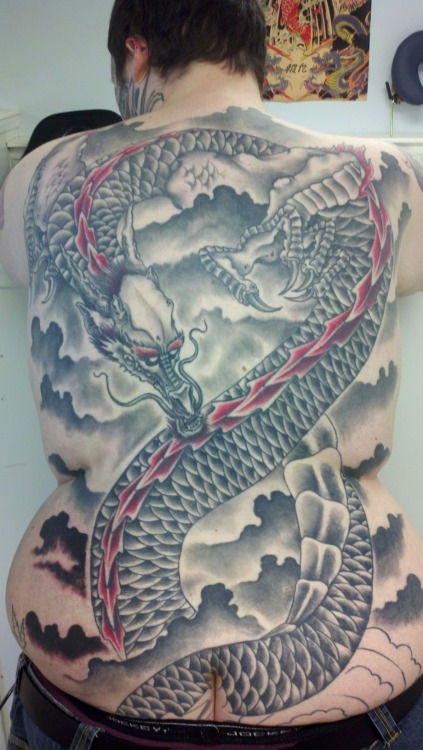 After a fresh session on my back tattoo. This is my dragon. It goes down and onto my butt and side of each leg. We are 45 hours into it and we still have more to do. Done by Zach Burcham of west main street tattoo glasgow, ky. Zach took this pic on his phone camera.