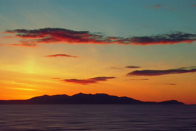 Red Clouds over the Yellow island of Arran by David Alexander Elder on Flickr.