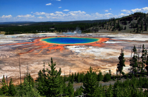 factandaphoto:  Yellowstone National Park's Grand Prismatic Spring, pictured above, is the largest hot spring in the US and the third largest in the world. The rainbow effect is naturally occurring, the result of pigmented bacteria in the area. (Photo via Wikimedia Commons)  Just so pretty. :)
