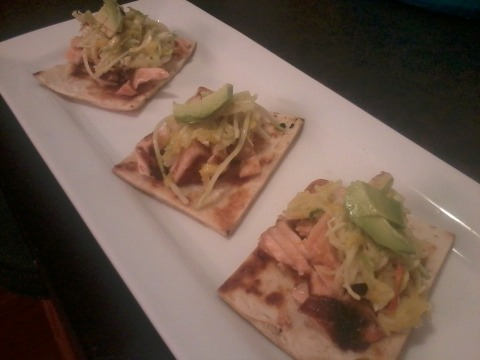 Mini salmon flatbreads with mango and avocado slaw topped with citrus ginger dressing.  I know I know. I eat a lot of avocado. But these were tasty and very easy to make. One small salmon fillet yields about 8 flatbread squares. Just season and pan sear a piece of salmon until cooked. Then crumble the fish lightly with a fork after it's cooled a little. Toss one cubed avocado, half a cup of diced mango, and about a cup of store bought broccoli or Asian slaw mix with your citrus dressing. You can make your own slaw but this is suppose to be easy. You should be able to find some decent slaw in the produce section of Publix. Toast 2 store bought flatbreads in the oven or on the grill then cut them into small appetizer size pieces (about 3 or 4 inches squared). Then all you have to do is assemble your flatbreads. But I think you can handle that. Oh yeah, and then eat them. Remember that once you toss your slaw in the dressing you must serve it with an hour or else it gets soggy.  Enjoy! Ingredients 2 store bought flatbreads (can substitute pitas or tortillas) 1 salmon fillet about 6-8 ounces  1 avocado  1/2 mango 1 cup asian slaw mix(from the produce section of your favorite grocery store) citrus ginger dressin Citrus ginger dressing 1 Tablespoon orange juice 1 Tablespoon lemon juice 1 Tablespoon honey 1 Tablespoon olive oil 1 Tablespoon vinegar (I prefer apple cider) 1 teaspoon fresh grated ginger 1 teaspoon Dijon mustard Salt and pepper, to taste