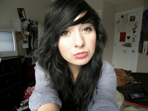 Girl With Long, Wavy Black Hair, Wearing A Nose Ring/Hoop & Gray Top
