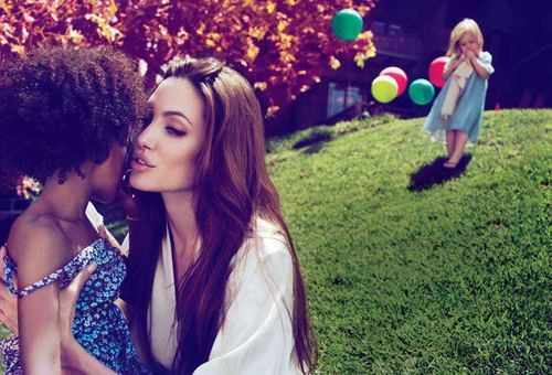 Angelina Jolie. Super Mom. :)  She's able to juggle her humanitarian works and being a mother, as well as a wife at the same time. That's really something because she's not just taking care of one kid.