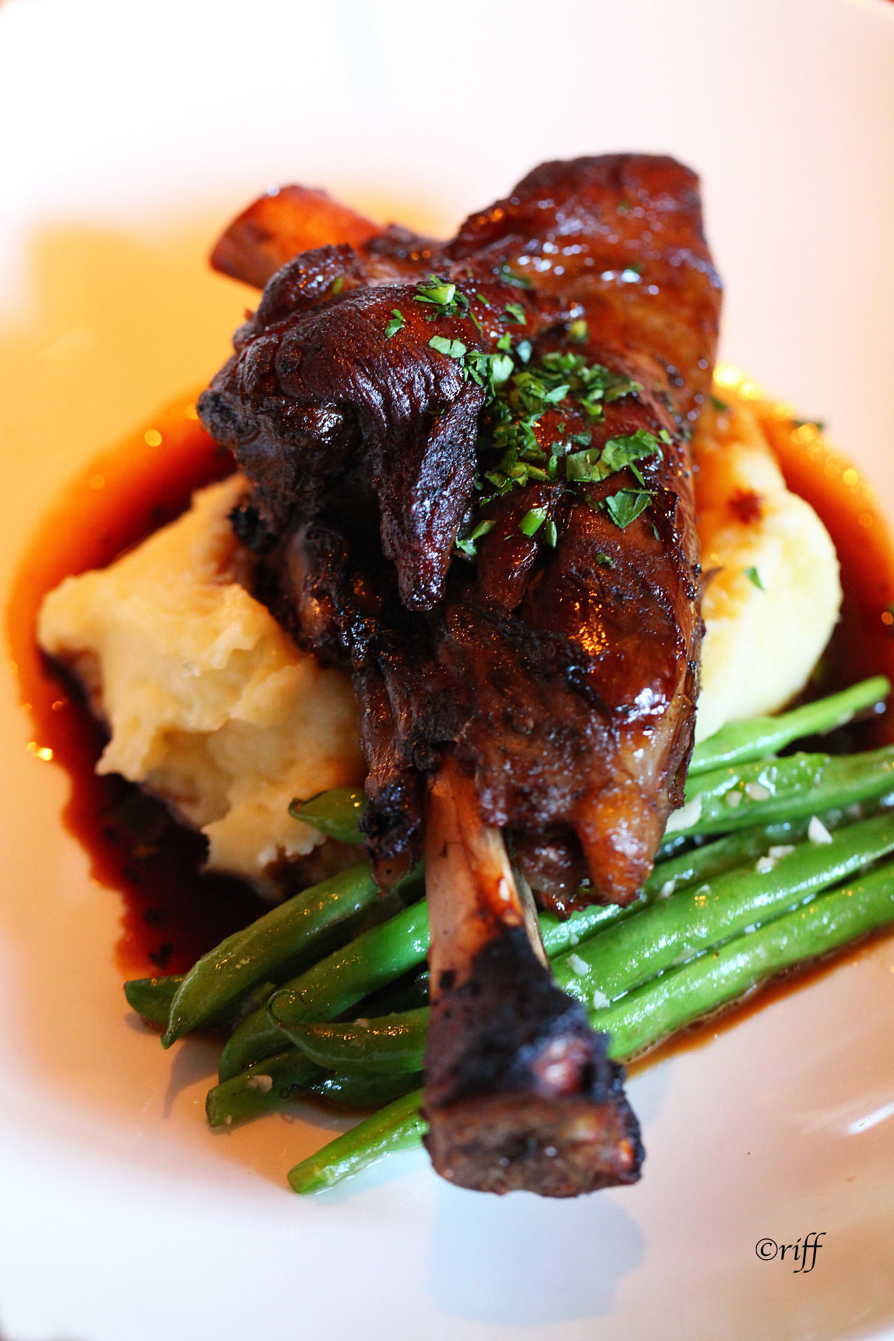 Rosemary Braised Lamb ShanksThis is a great meal to make when you have company coming over: the prep is done in advance - and you can enjoy the guests while dinner cooks!There are a lot of good recipes out there, but this is my favorite.Ingredients:6 lamb shankssalt and pepper to taste2 tablespoons olive oil2 onions, chopped3 large carrots, cut into 1/4 inch rounds10 cloves garlic, minced1 (750 milliliter) bottle red wine1 (28 ounce) can whole peeled tomatoes with juice1 (10.5 ounce) can condensed chicken broth1 (10.5 ounce) can beef broth5 teaspoons chopped fresh rosemary2 teaspoons chopped fresh thymeDirections:Sprinkle shanks with salt and pepper. Heat oil in heavy large pot over medium-high heat. Working in batches, cook shanks until brown on all sides, about 8 minutes. Transfer shanks to plate.Add onions, carrots and garlic to pot and saute until golden brown, about 10 minutes. Stir in wine, tomatoes, chicken broth and beef broth. Season with rosemary and thyme. Return shanks to pot, pressing down to submerge. Bring to a boil, then reduce heat to medium-low. Cover, and simmer until meat is tender, about 2 hours. Given the luxury of time, I like to simmer even longer, until the meat is just about falling off the bone!Remove cover from pot. Simmer about 20 minutes longer. Transfer shanks to platter, place in a warm oven. Boil juices in pot until thickened, about 15 minutes. Spoon over shanks. Try serving with mashed potatoes, or polenta: you really need something that can sop up all that wonderful jus!