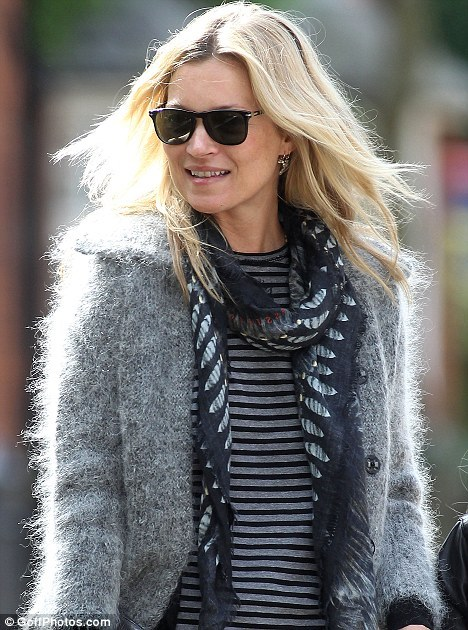 Celebrity Scarf Watch: Kate Moss wearing a printed black scarf in Highgate, London.