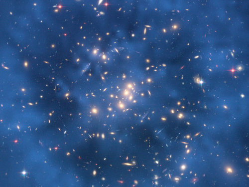 cosmictoquantum:  Dark Matter Collides with Human Tissue an Average of once a Minute, Study Finds  A dark matter particle smacks into an average person's body about once a minute, and careens off oxygen and hydrogen nuclei in your cells, according to theoretical physicists. Dark matter is streaming through you as you read this, most of it unimpeded. Dark matter is arguably the greatest mystery in modern physics. Observations from multiple sources across a few decades now shows that most of the universe is made of matter we can't see — hence the name — but no one has been able to find it. One strong candidate for this dark material is called a WIMP, for weakly interacting massive particle, and there are a variety of observatories in Europe and the U.S. that are looking for these things. Some have found promising hints, but others have seen a whole lot of nothing. Still, cosmologists generally agree there's a halo of dark matter particles out there, and our solar system and our planet are flying through it. In a new paper, Katherine Freese at the University of Michigan and Christopher Savage at Stockholm University in Sweden thought about what this means for our bodies. We know dark matter does not interact normally with regular matter — otherwise we'd be able to see it — so that means most of the particles pass through us. But some might interact with a hydrogen or oxygen nucleus, changing their energies or spins. The researchers use a 70-kg human (about 155 pounds) as an example, and calculate how many particles may be careening around based on signals from the DAMA, CoGeNT and CRESST experiments. Of the billions of high-energy WIMPs passing through a body every second, fewer than 10 hit a body's nuclei in a given year. But lower energy WIMPs make impact much more frequently, around 100,000 collisions per person per year. That's about one per minute. What does this mean? Maybe nothing, in terms of impacts on human health — cosmic and solar radiation also rains down on us all the time, and it has many more detrimental effects. But it's interesting to think that we ourselves could be dark matter detectors. The paper is posted on the astrophysics arXiv preprint server. Rebecca Boyle, Popsci.com