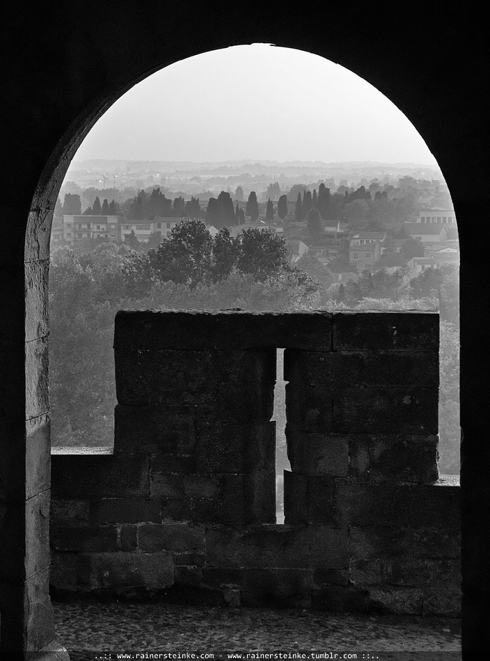 Gate through the old fortification Wall of Carcassonne - France A bit foggy outside!