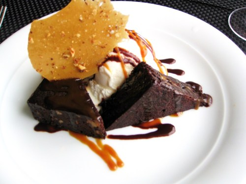 Warm Espresso Chocolate Brownie with Macadamia Nut Ice Cream and Caramel Brittle from Cagney's Steakhouse on the Norweigian Cruise Line Sky.