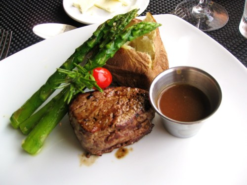 Cagney's Steakhouse on the Norweigian Cruise Line Sky 5 oz Filet Mignon with Cabernet Sauvignon Demi-Glace, Roasted Asparagus, Baked Idaho Potato