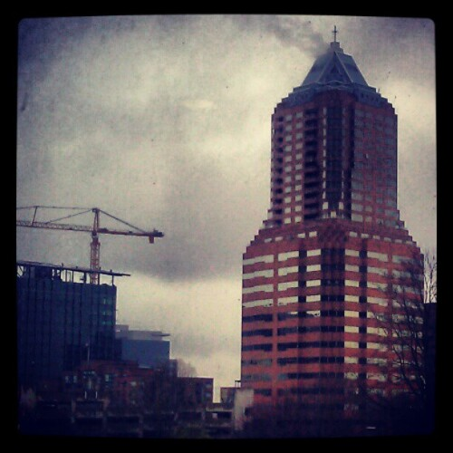 treasurecove:  early mornings. #pdx #Oregon #gray #cloudy #sky #skyscraper #buildings #downtown #crane #construction #overcast (Taken with instagram)