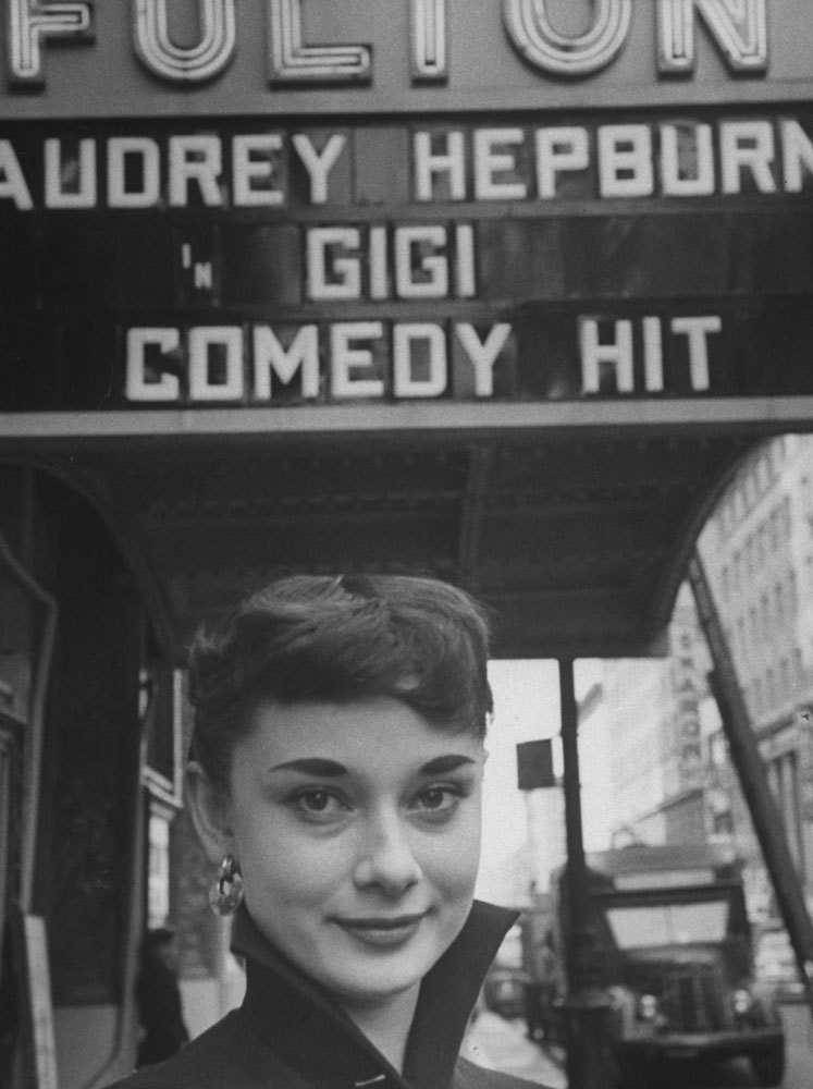 theniftyfifties:  Audrey Hepburn posing under a theater marquee for the stage version of 'Gigi', 1951.