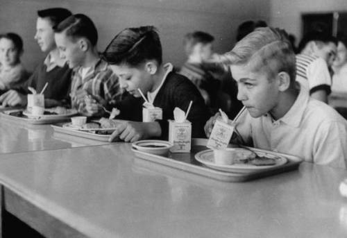 Boys eating in the school cafeteria, VA, US, March 1956.