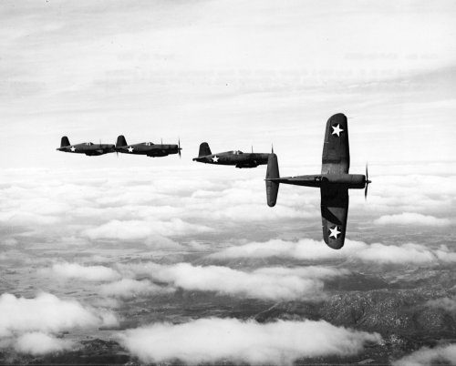 "F4U-1 Corsairs of Fighting Squadron VF-12 in flight on March 23 1943 The section leader peels off from formation in this image showing F4U-1 Corsairs of Fighting Squadron (VF) 12 in flight on March 23, 1943. VF-12 was the first Navy squadron to receive the ""Bent Wing Bird."""