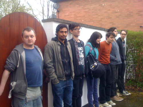 All our tour buddies lining up outside Anna's house to ask her out to play.
