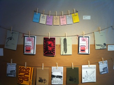 The Temporary Autonomous Zine Reading Room (an exhibition of zines from the Mills community) is now up & running! Come by & sit down, read & respond to zines by students, former students, staff & dropouts! Featuring work by Annah Anti-Palindrome, Jess Heaney, Camille Robles, Maya Weeks and many others. There's even a zine-exchange basket, so bring a zine you've made to share! There's also a typewriter for you to type responses to zines on.  WHEN? M-F 9:30am-5:30pm TODAY until FRIDAY APRIL 20th WHERE? The Book Art Pocket Gallery (CPM 121) If you have any questions about the Book Art Pocket Gallery, ask Emji Spero (eglen@mills.edu)!
