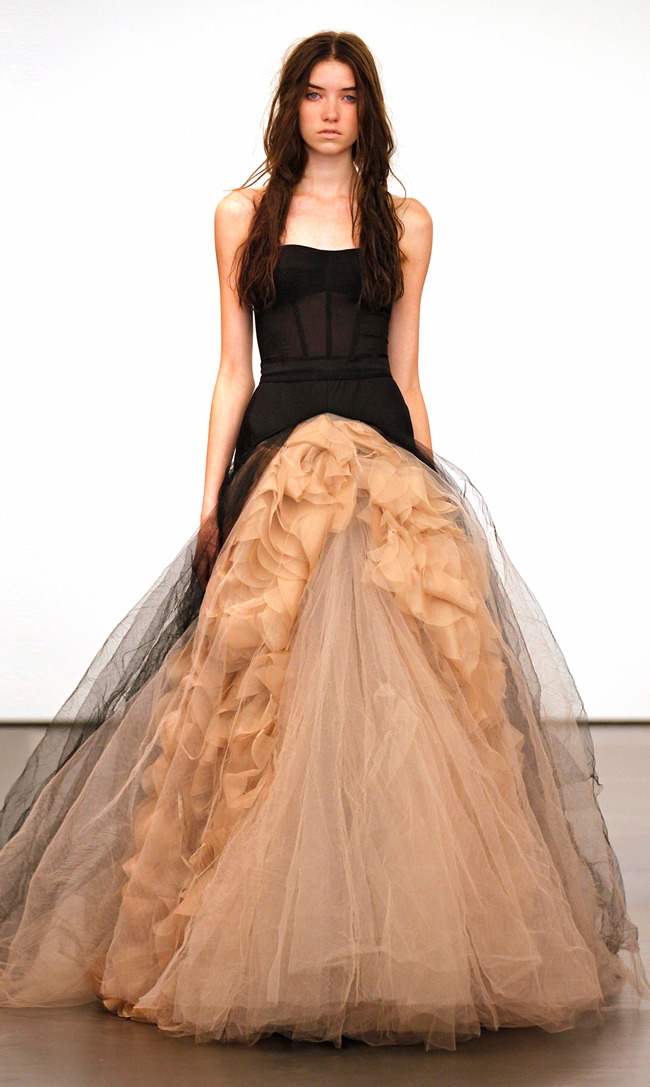 "Vera Wang | Fall Bridal 2012   Vera Wang's stunning and sought after wedding gowns took a turn towards the dark side last season. V's ""witchcraft"" inspired bridal collection uses a abundance of carefully organized tulle in black and creamy nudes. Always accentuating the waist, we see lots of the strapless corset styled bodice followed by long layered fabrics in mermaid and ballroom cut skirts. Click on the title link above to view the entire collection or the link below for a backstage video and synopsis of the show. Her Spring 2013 Bridal Show will take place on April 15th. ____________________________________________________________ ⓥ Vera Wang Fall 2012 Bridal: Backstage/Runway Show Video ⓥ Vera Wang Official Website"