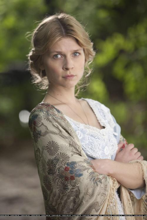 Birdsong - Clémence Poésy as Isabelle Azaire, wearing a Japanese fringed shawl over a pale blue dress with lace inserts.